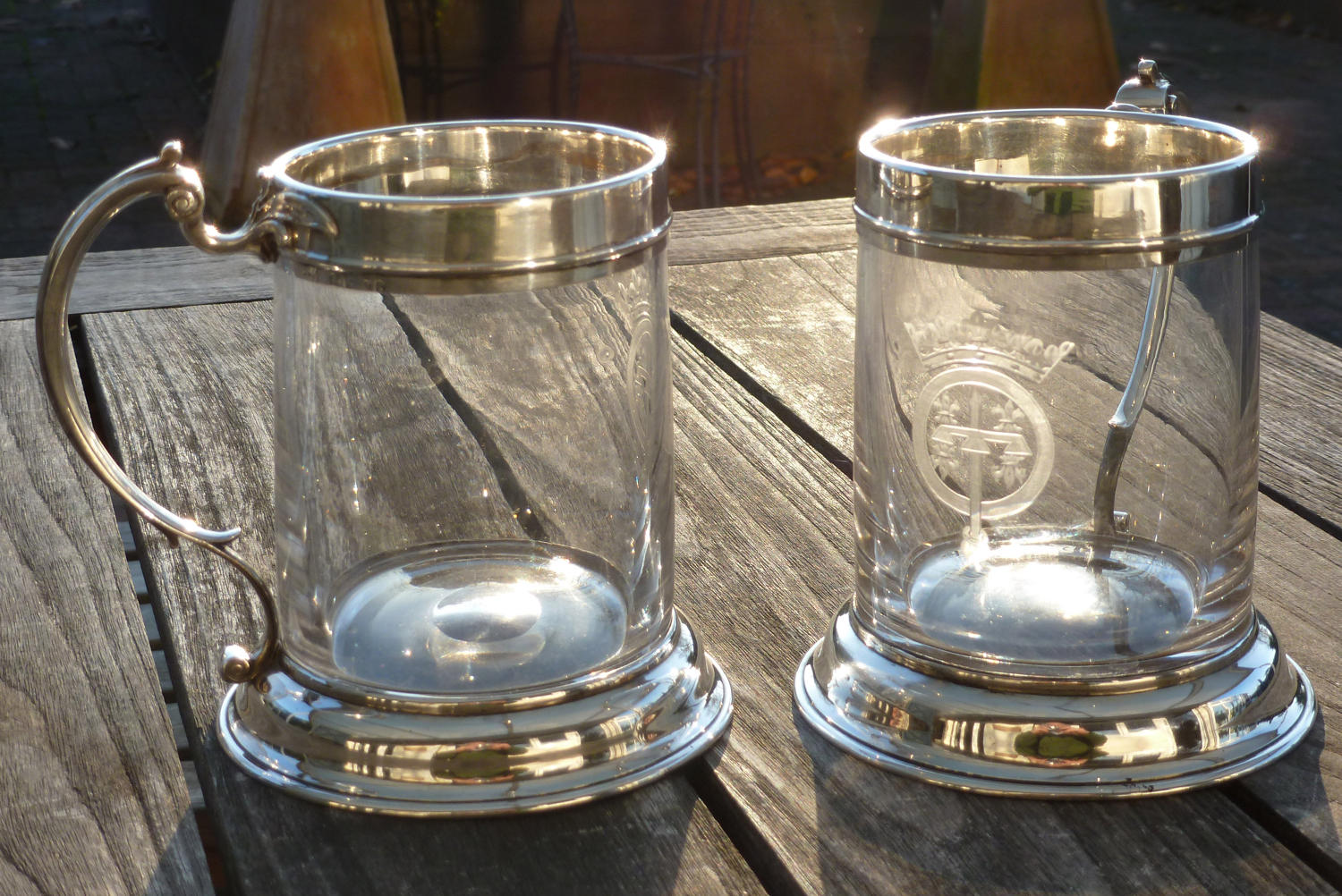 6610 A rare pair of silver-mounted armorial mugs