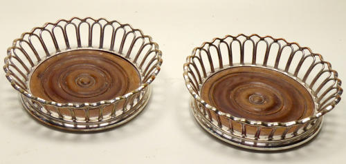 6619 a pair of silver plated 'wirework' coasters.