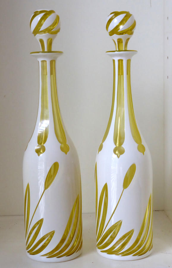 6631 A pair of F & C Osler white over yellow overlay decanters