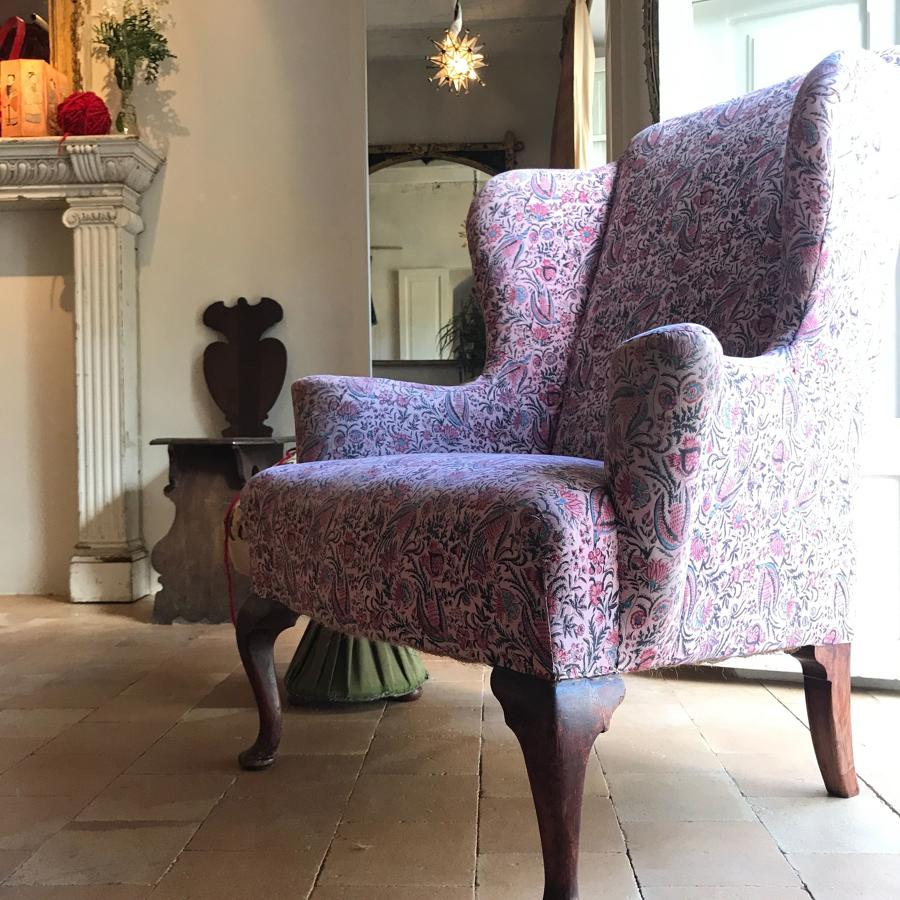 A very large Howard & Sons Wingback Armchair