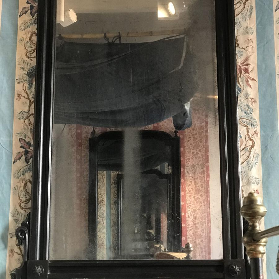 A 19th century Mallorquin Ebonised Mirror