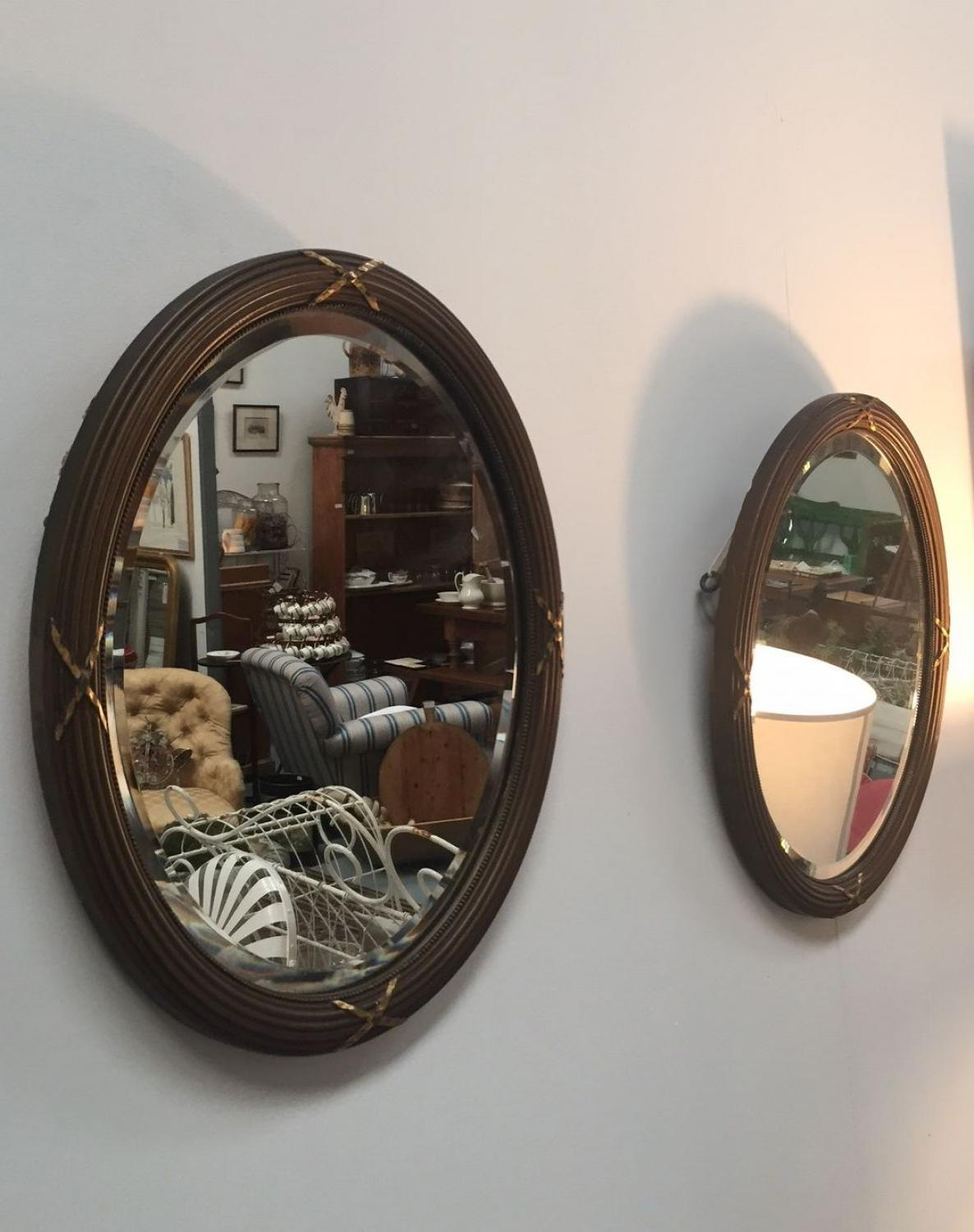 Pair of Edwardian Oval Bevelled Mirrors