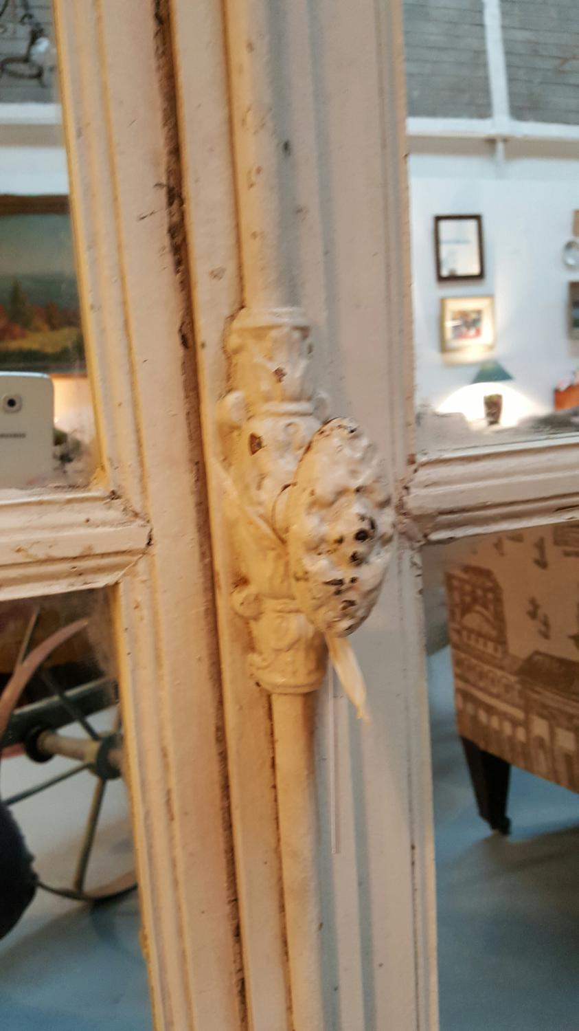 Pair of salvaged French windows with mirrors