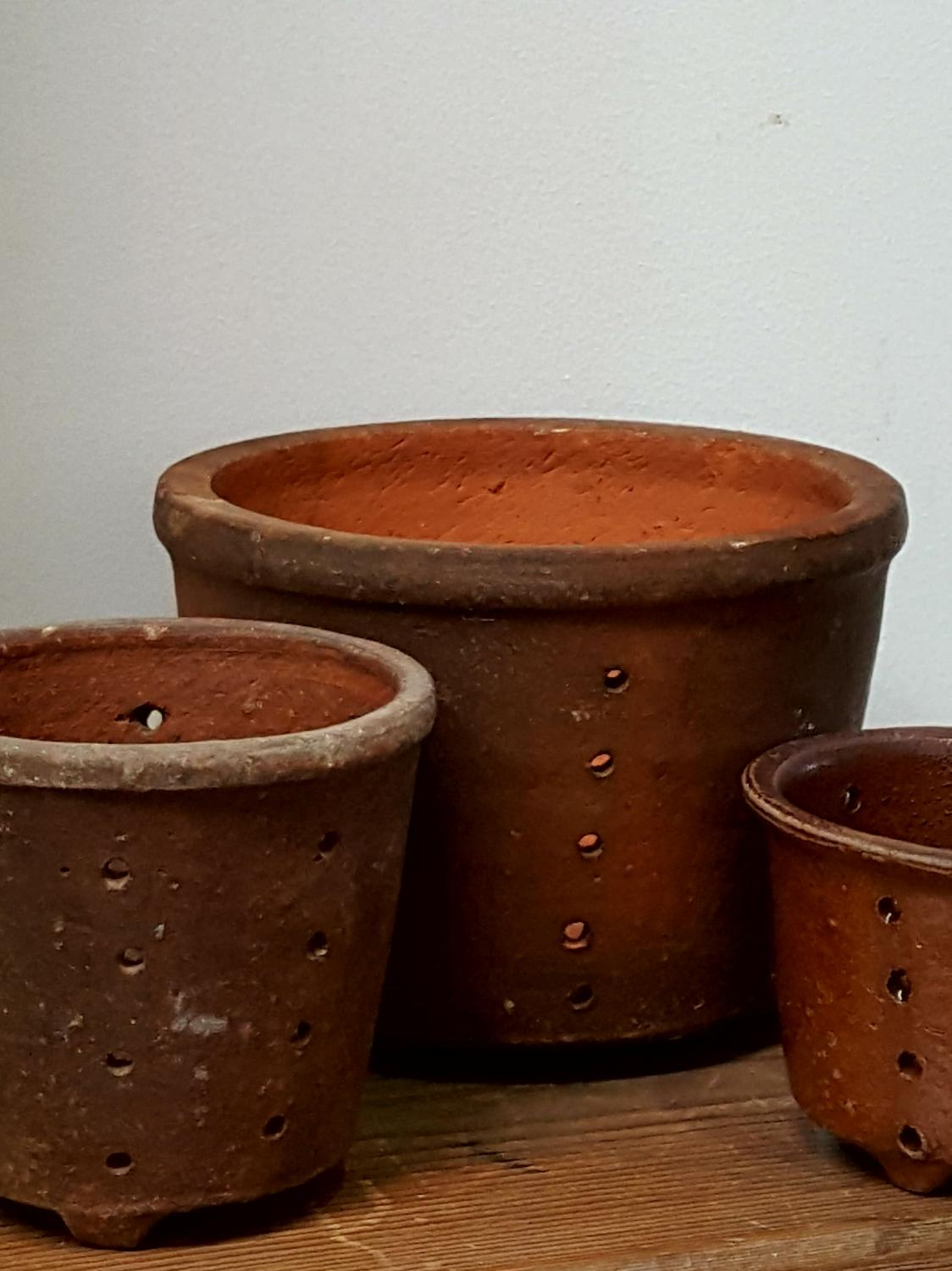 Selection of Antique pottery cheese strainers