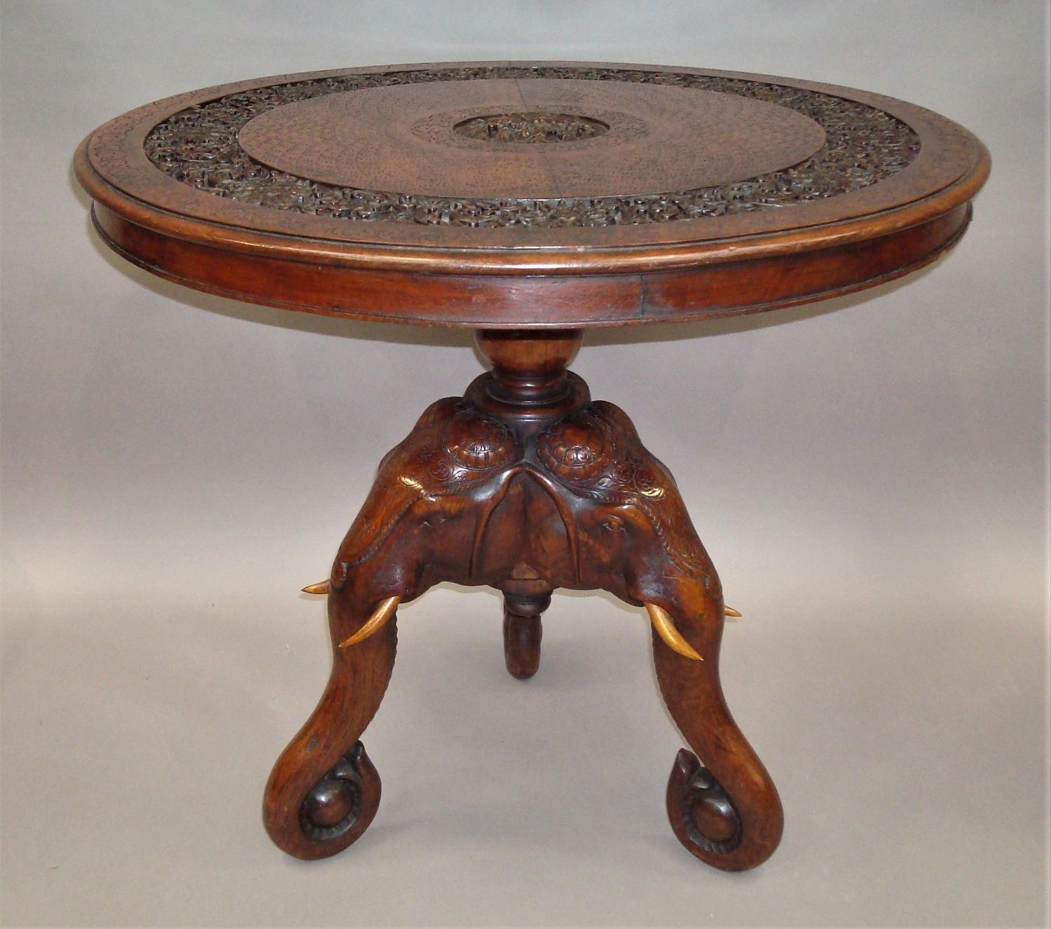 C19th Indian finely carved teak elephant table