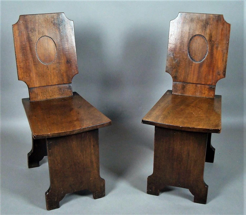 Regency pair of mahogany hall chairs