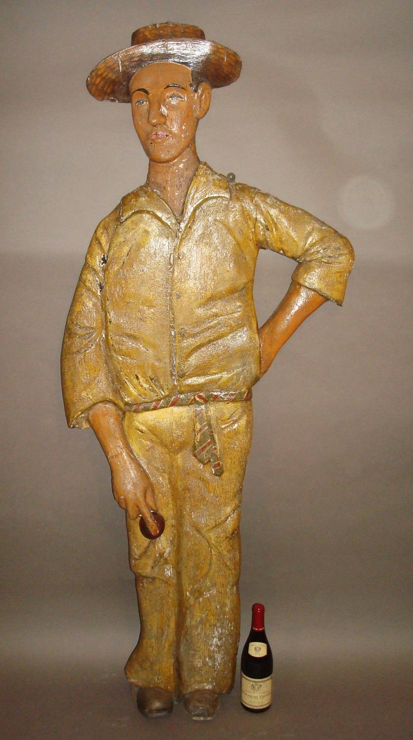 C20th carved wood and painted colonial cricketer