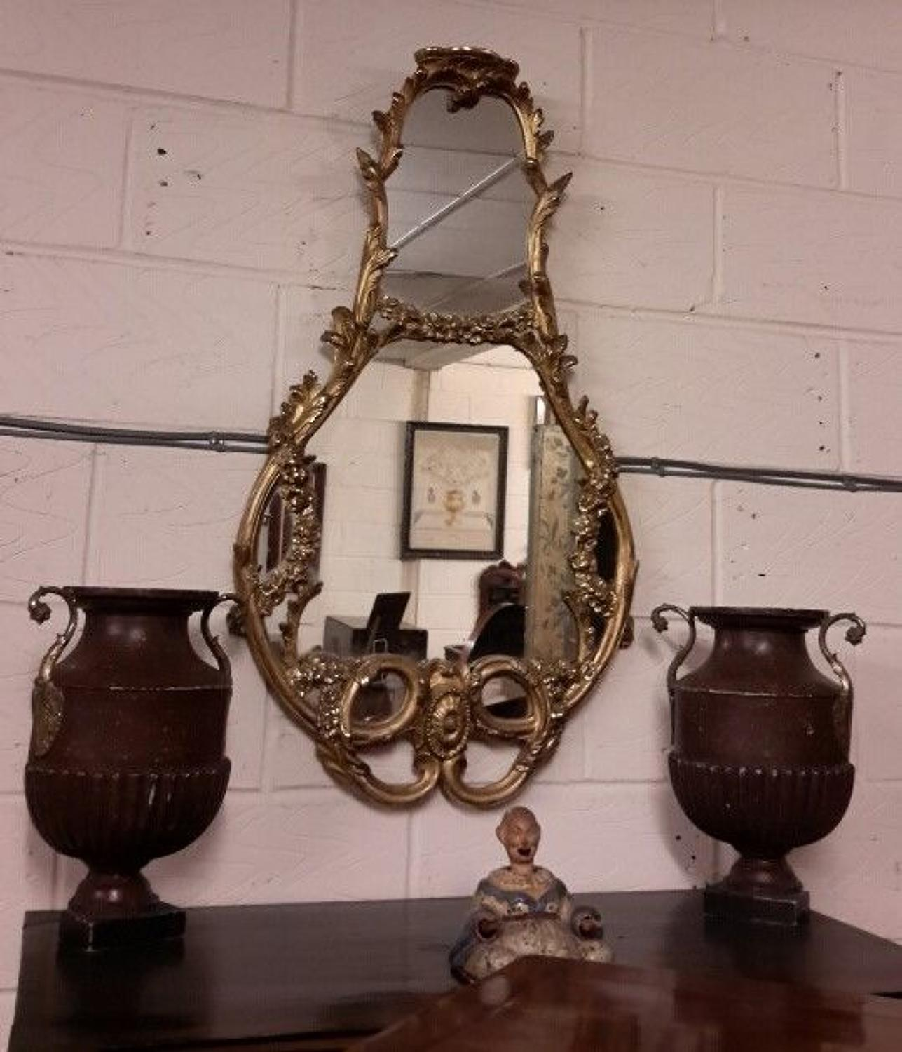 C19th shaped giltwood and gesso wall mirror