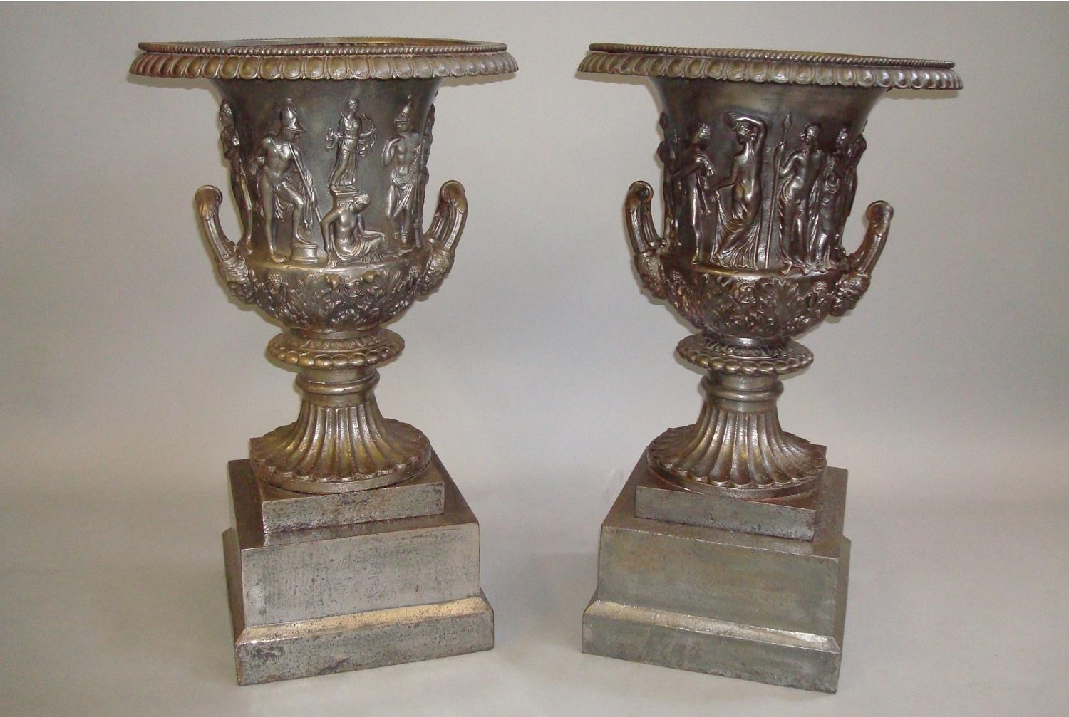 C19th pair of burnished cast iron campanan urns