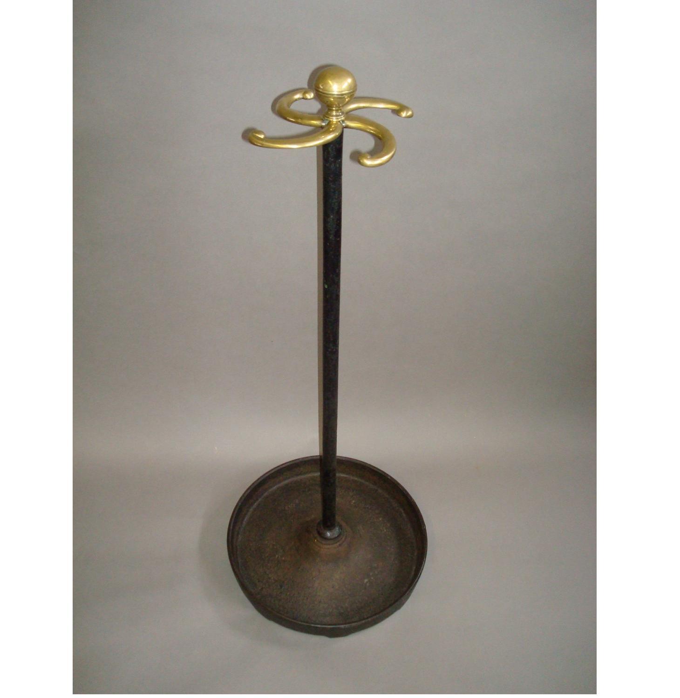 Regency cast iron and brass stick stand