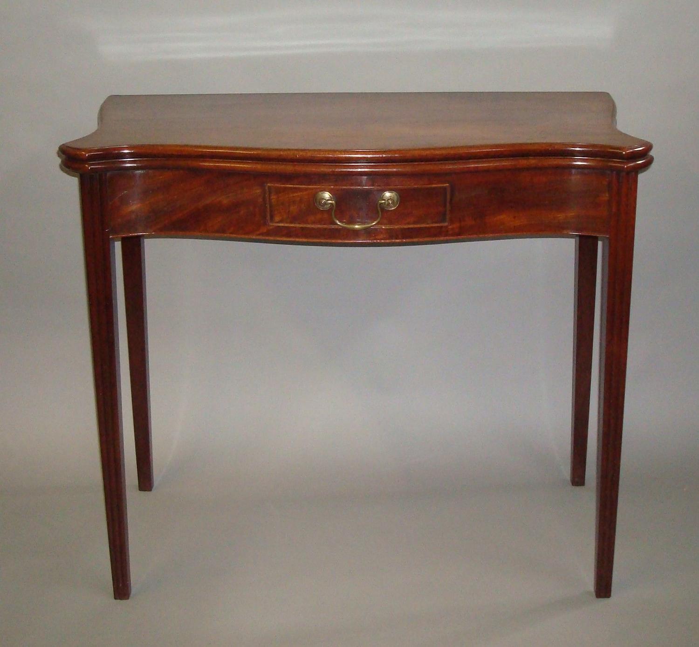 George III serpentine mahogany tea table