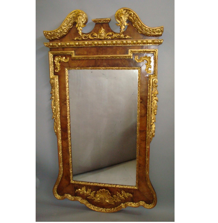 George II walnut and parcel gilt wall mirror