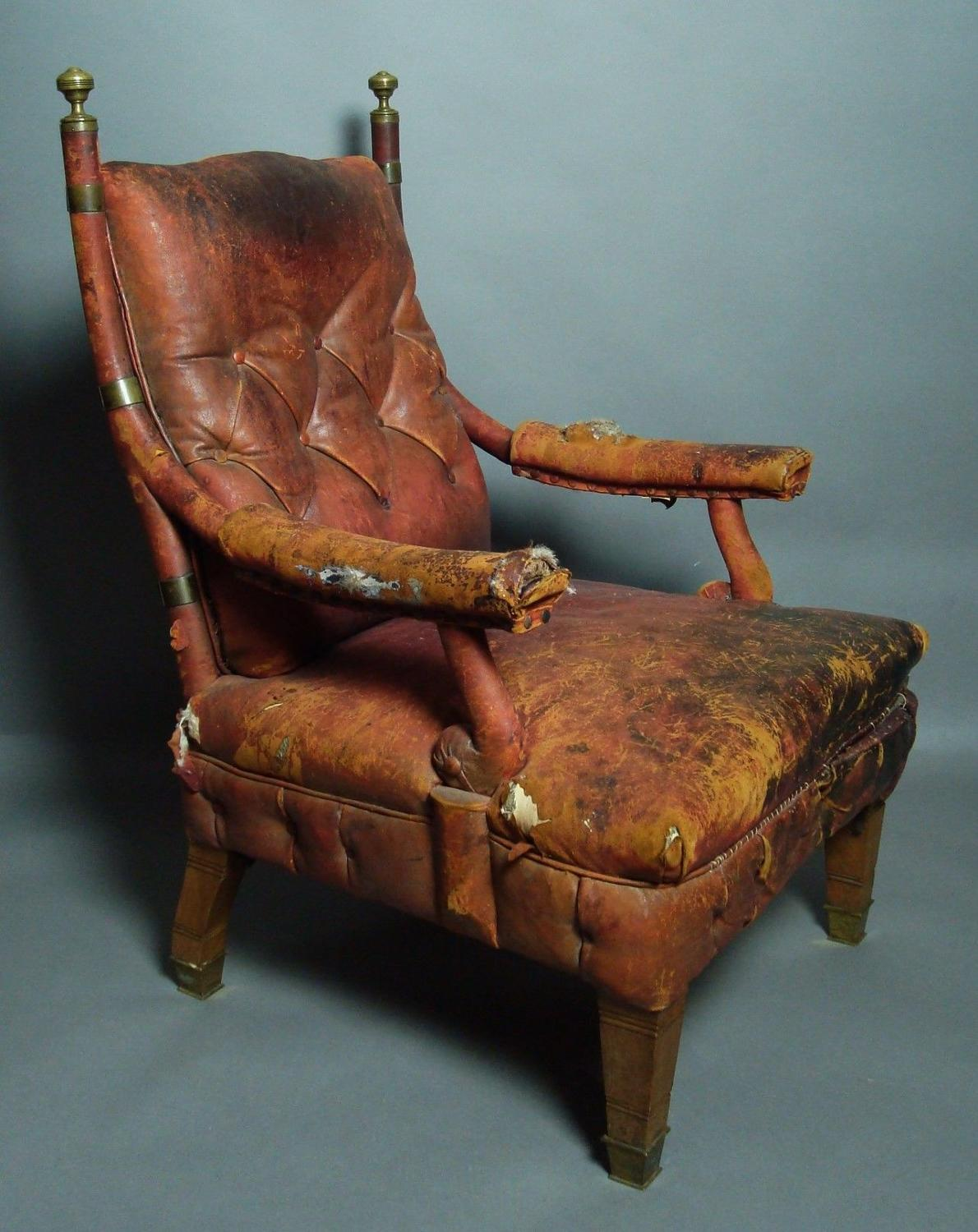C19th querky mahogany and leather library chair