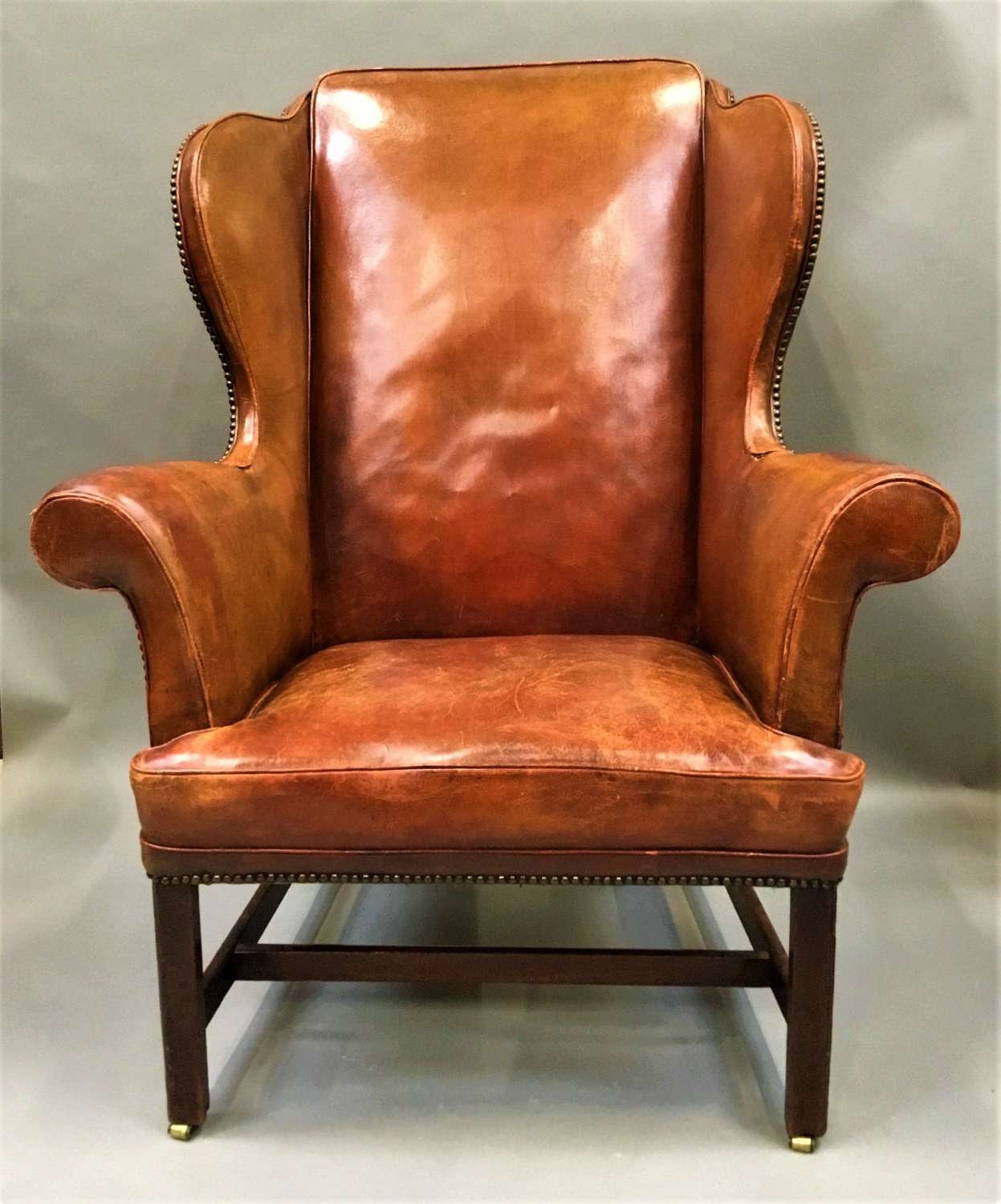 George III mahogany and leather wing chair