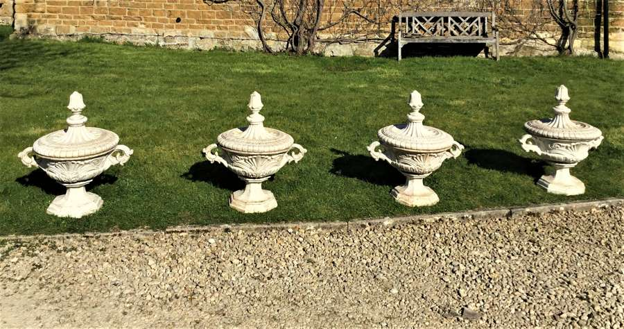 Late C19th rare set of four cast iron terrace / garden urns