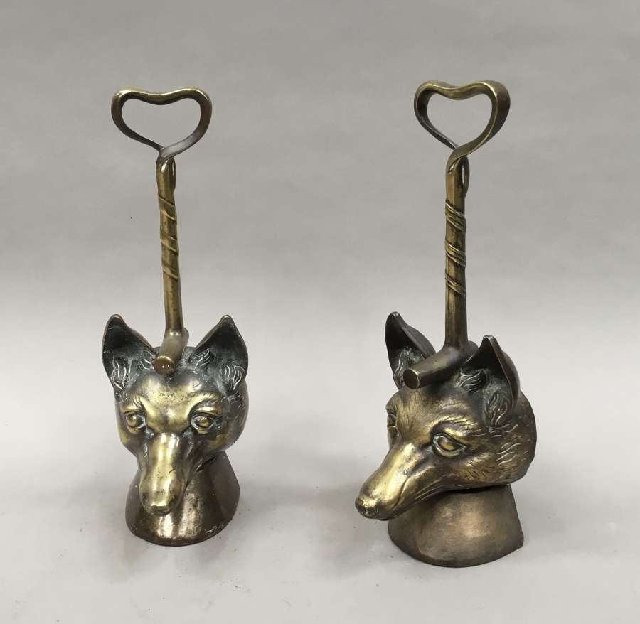 C19th matched pair of brass fox head doorstops / door porters