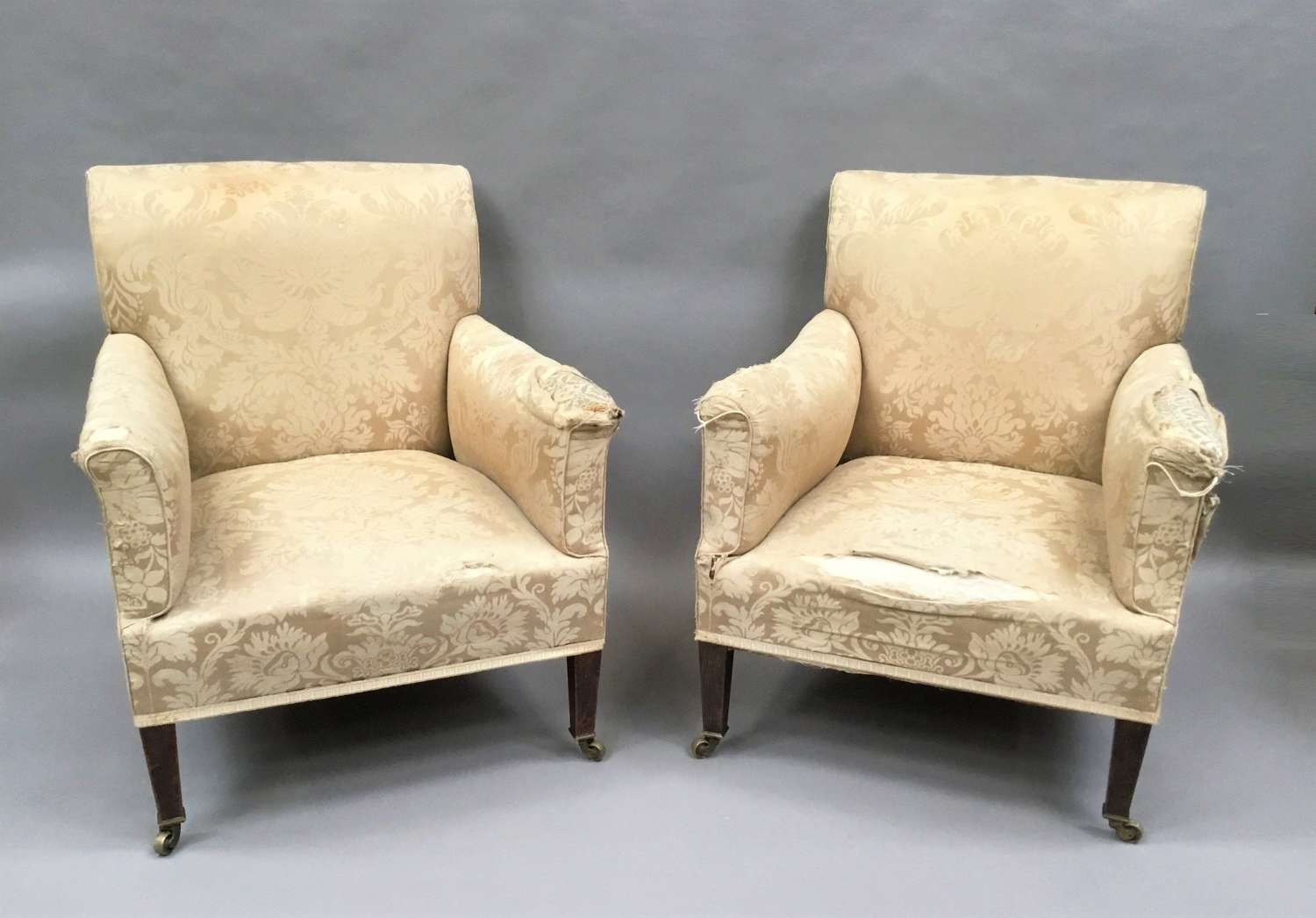 C19th Howard and Sons pair of upholstered library chairs / armchair