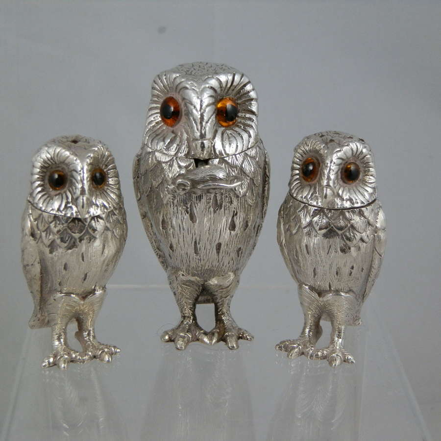 A William Comyns three piece owl condiment set. 1968