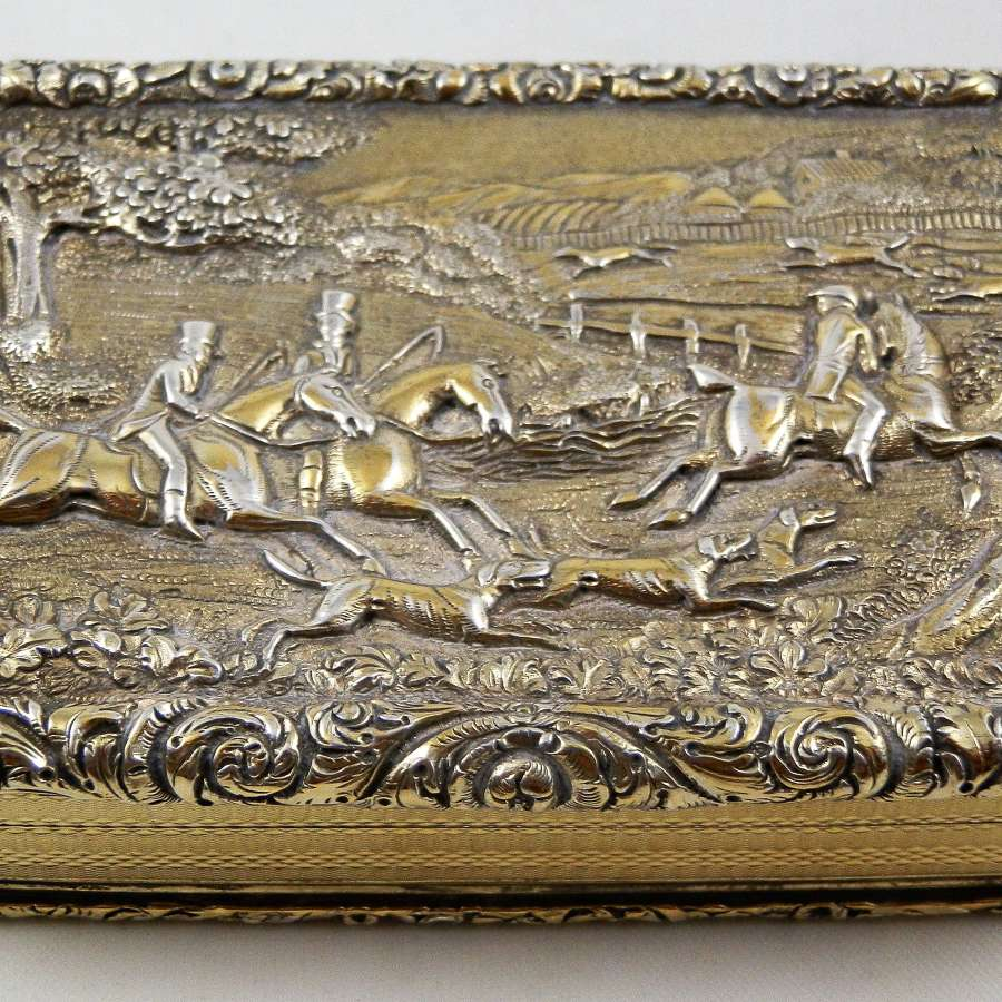 A George IV hunting scene silver gilt table snuff box, 1829