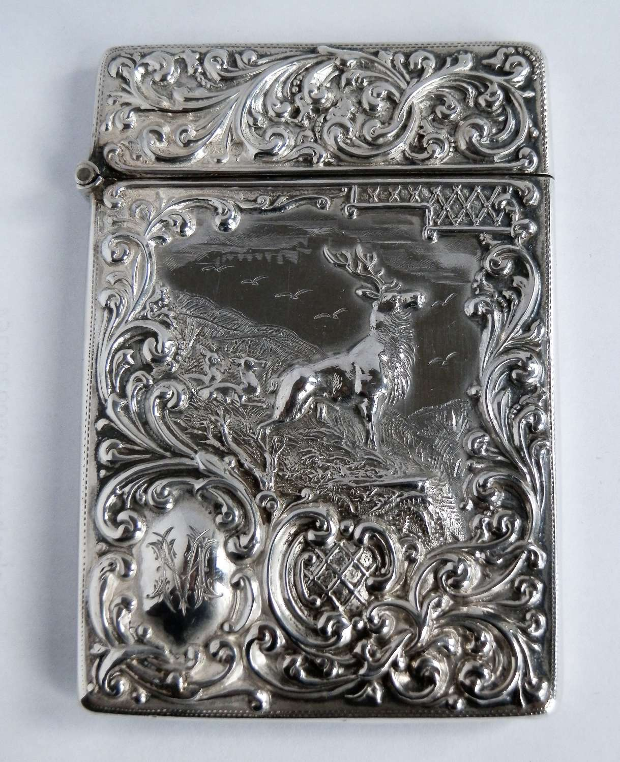 An Edwardian silver card case with a stag, 1904