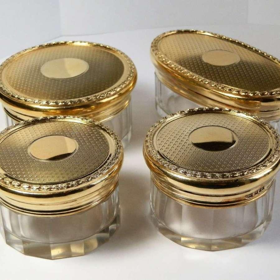 Set of 4 silver gilt dressing table jars, London 1929