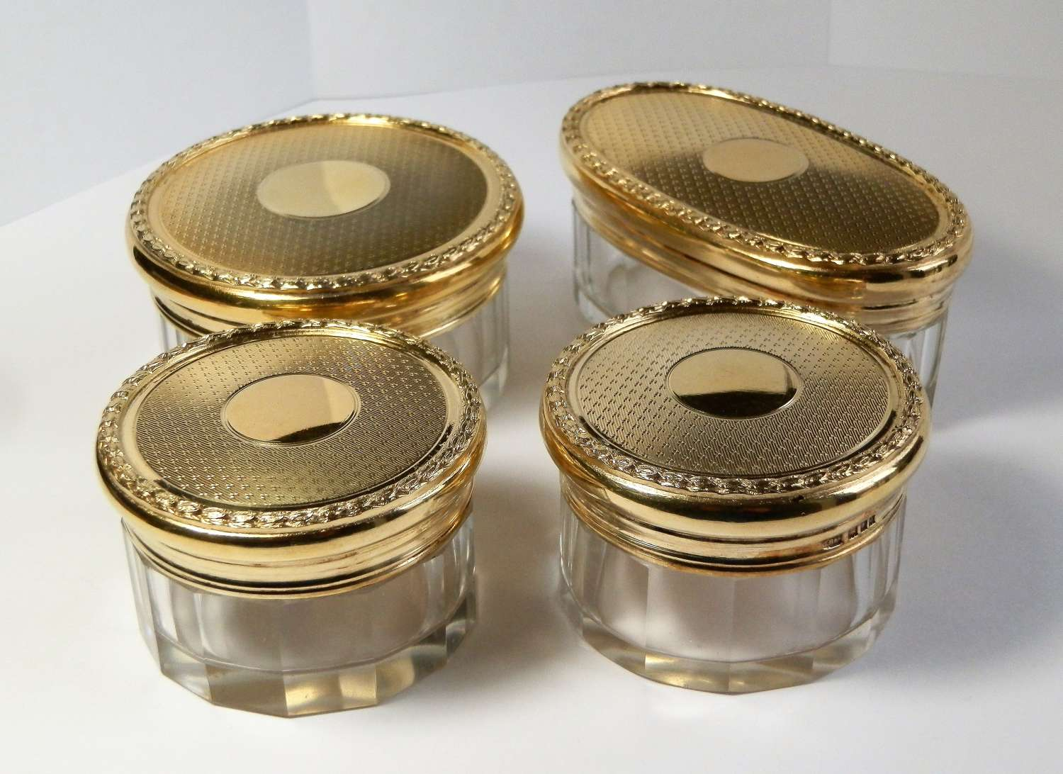 Set of 4 silver gilt dressing table jars, London 1929