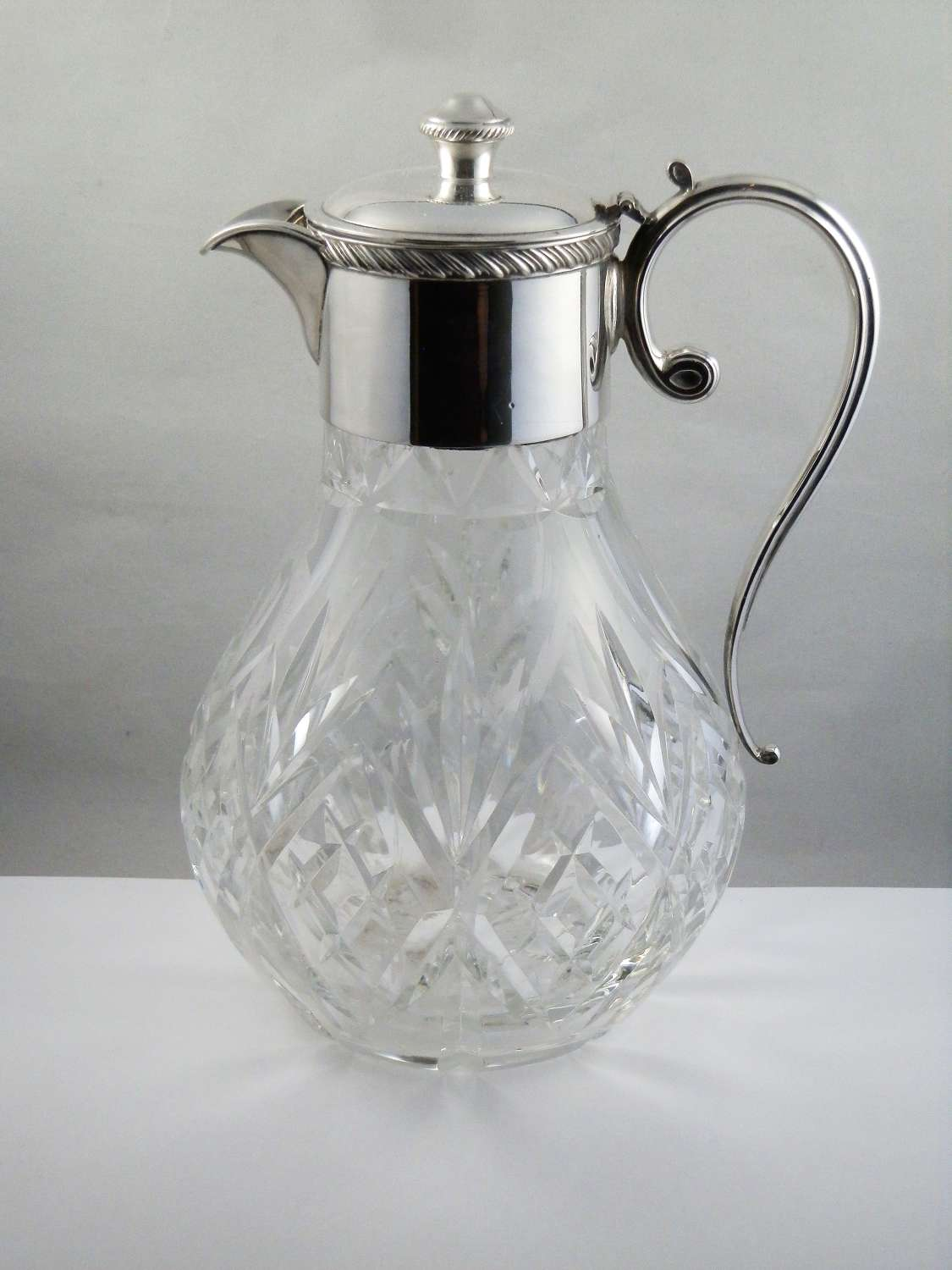 Elizabeth II silver and glass claret jug, 1979