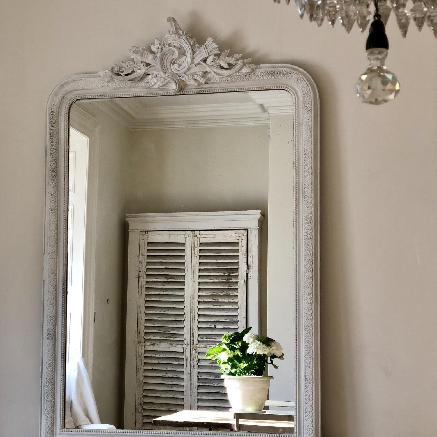 Huge crested 19th century French antique painted leaner mirror