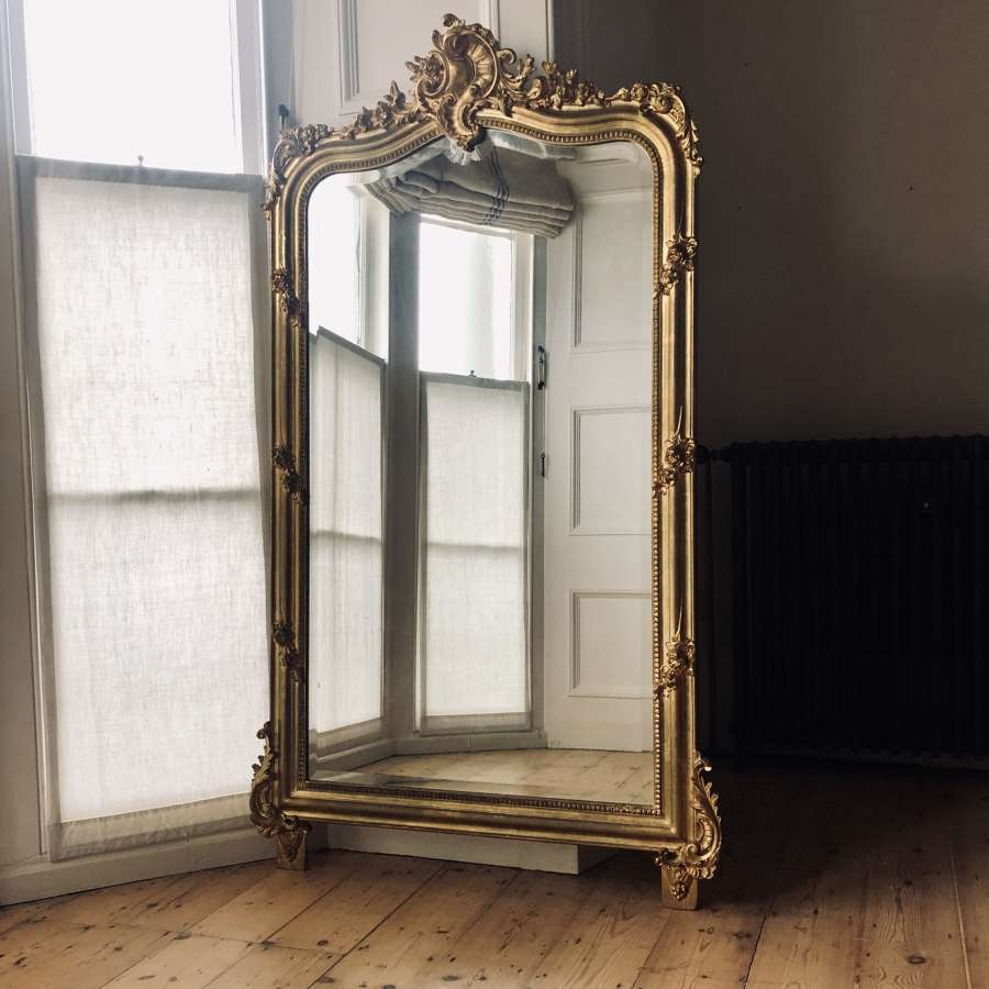 Antique French Louis XV crested gilt leaner mirror