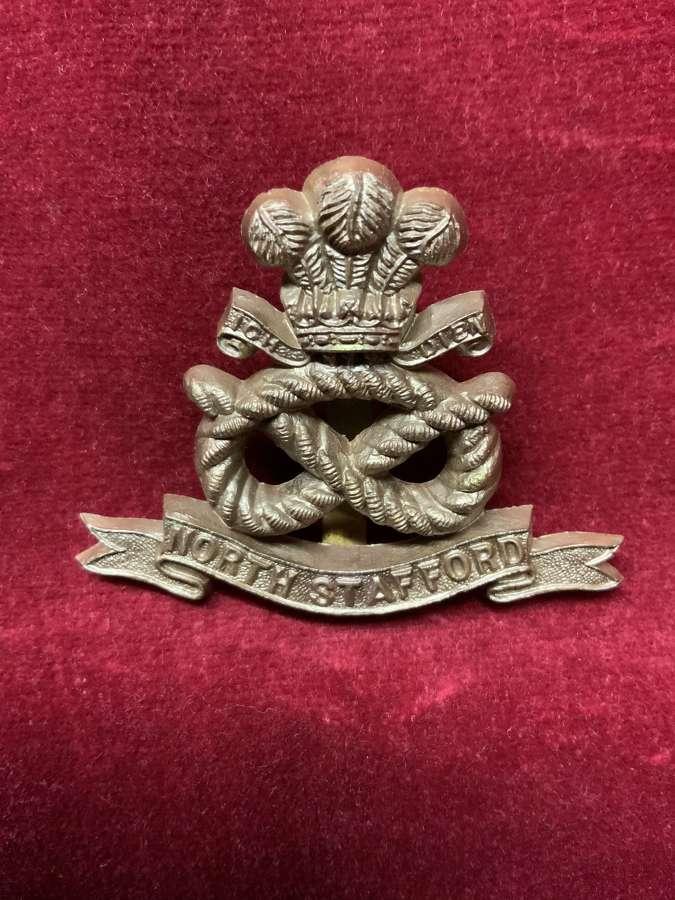 North Stafford Plastic Cap Badge Bronze.