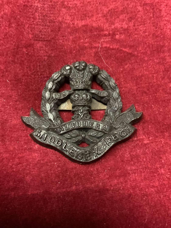 Middlesex Regiment Plastic Cap Badge Brown.