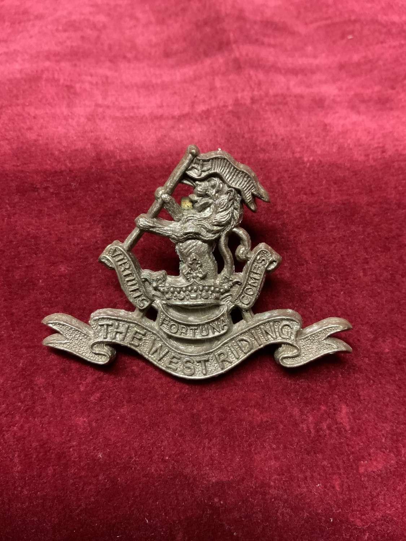 The West Riding Regiment Silver Coloured Plastic Cap Badge