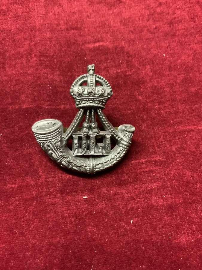 Durham Light Infantry Silver Coloured Plastic Cap Badge