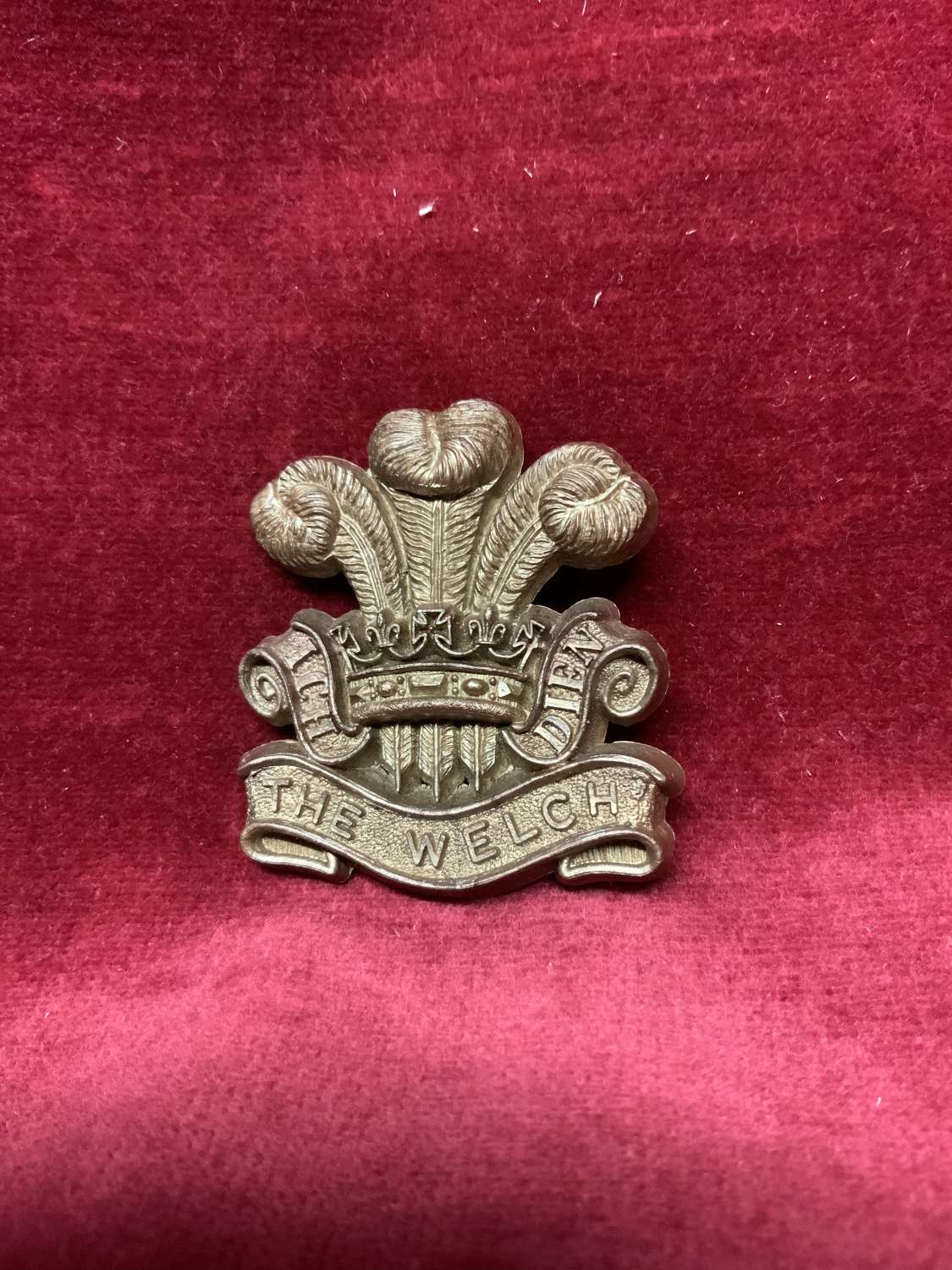 The Welch Regiment Bronze Coloured Plastic Cap Badge