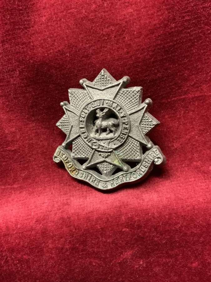 Bedfordshire & Hertfordshire Regiment Silver Coloured Plastic Cap Badg