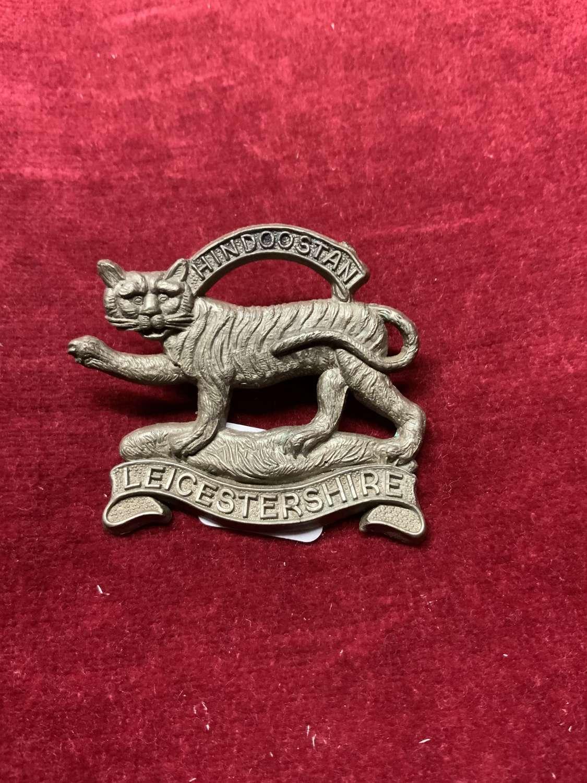 Leicestershire Regiment Silver Coloured Plastic Cap Badge
