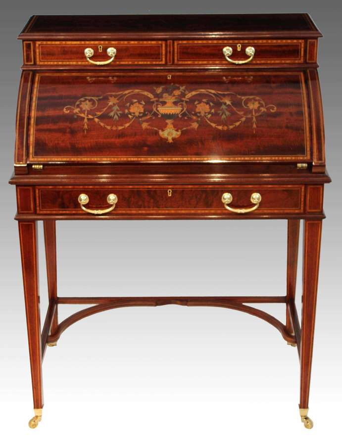 A Beautiful Late Victorian Mahogany cylinder desk by Maple & Co.