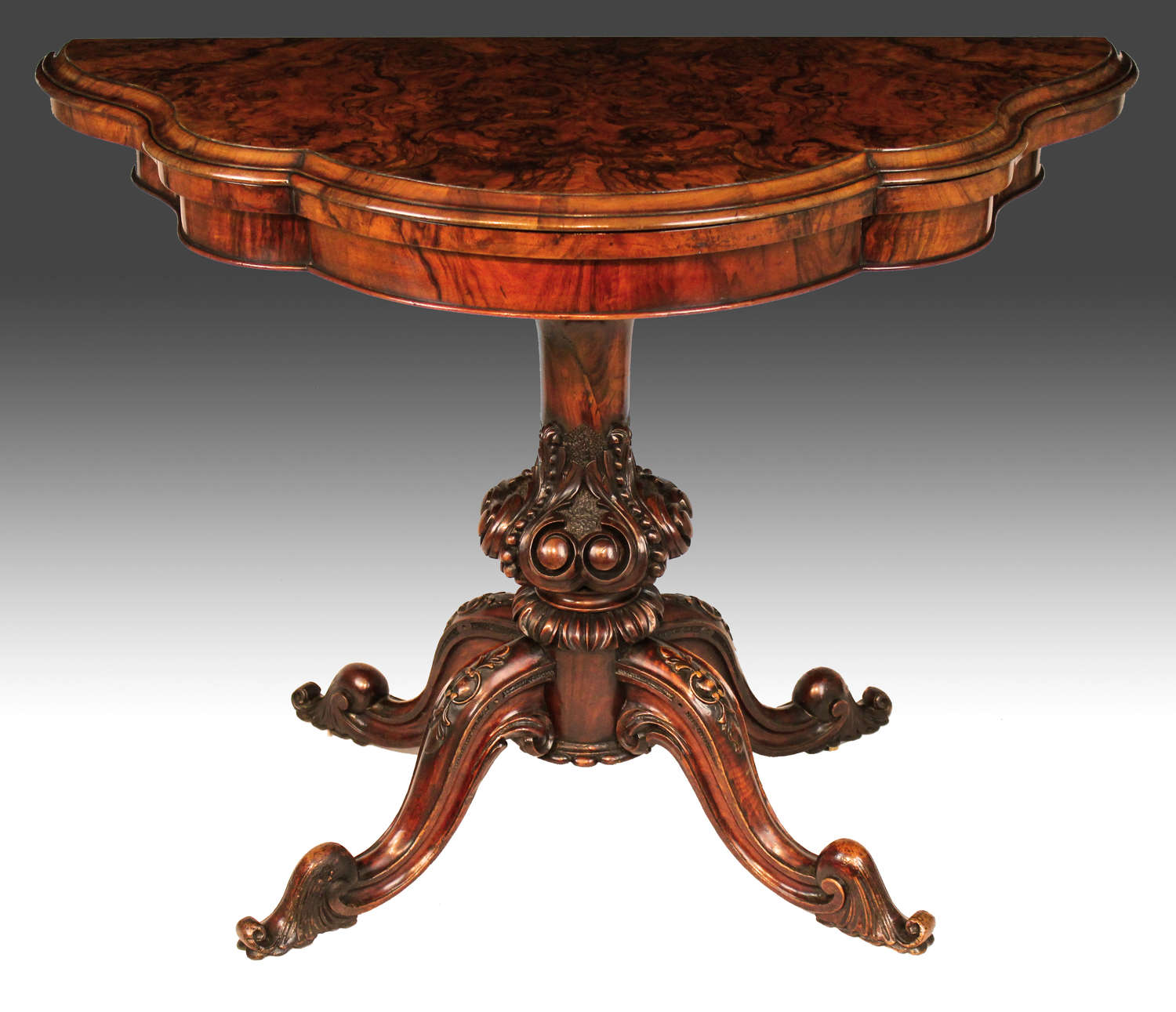 A Late Victorian Burr Walnut Serpentine Shape Card Table