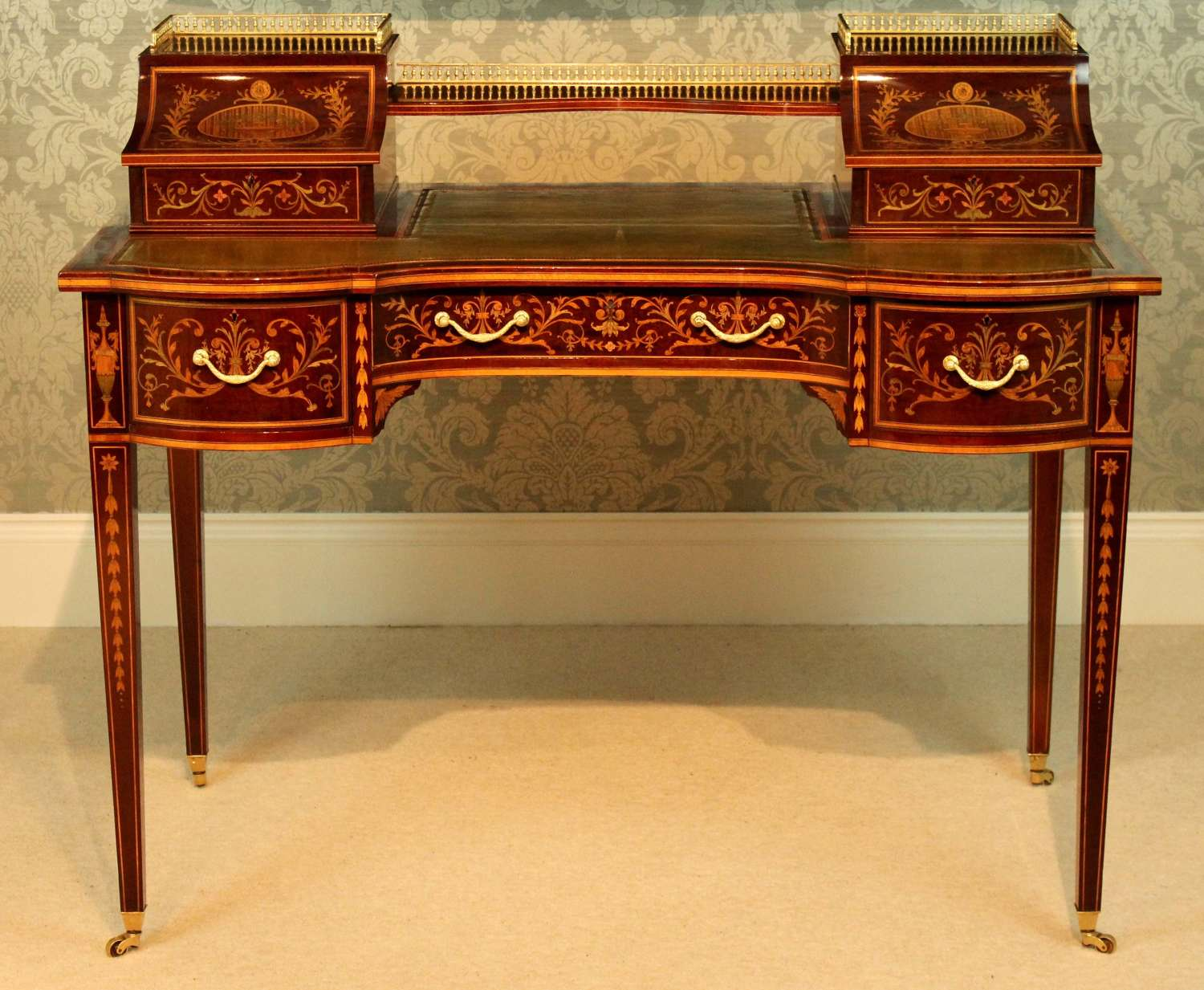 A Late Victorian Mahogany Inlaid Carleton House Style Desk