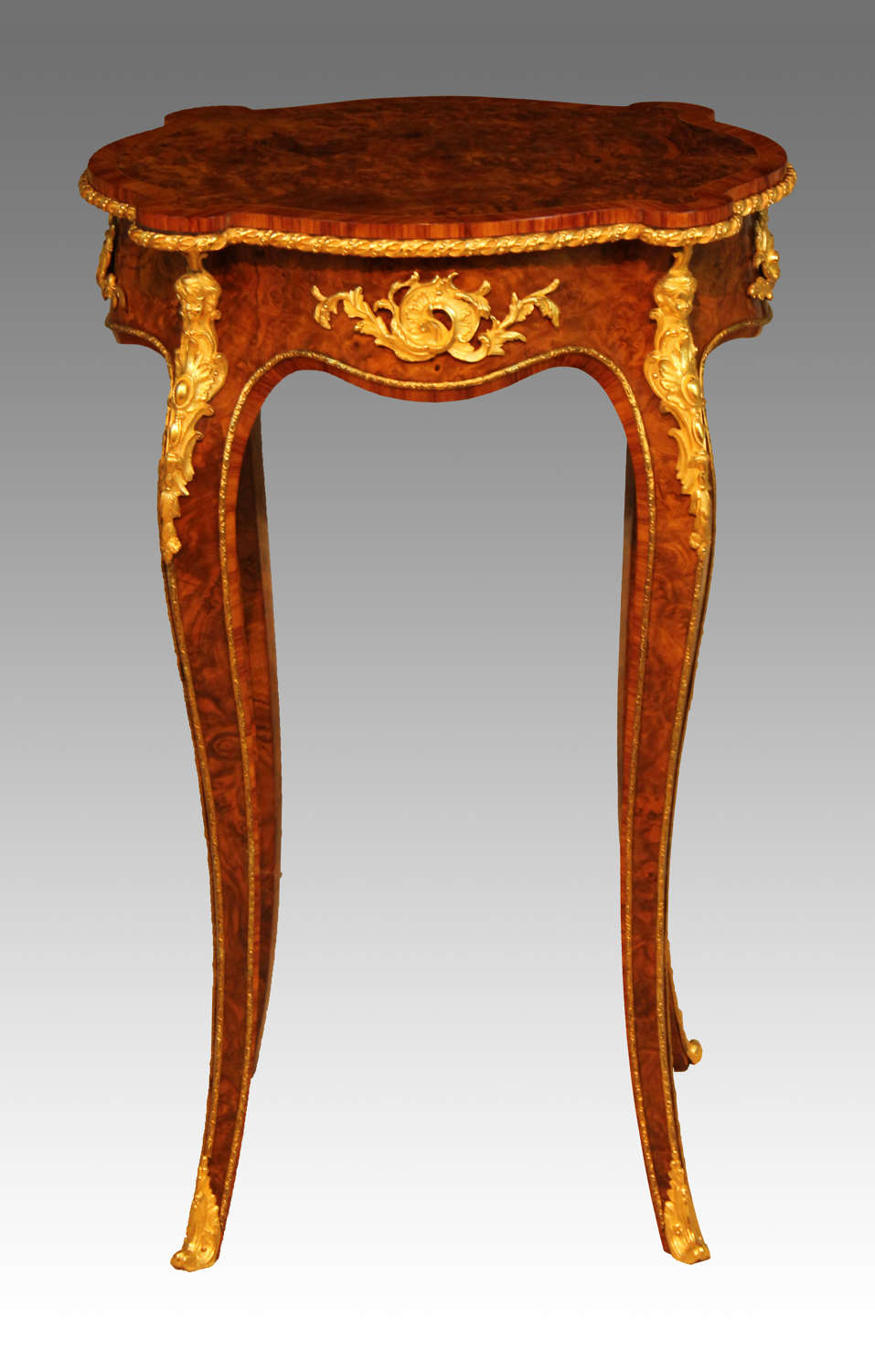 A Victorian Burr Walnut Inlaid and Ormolu Mounted Table