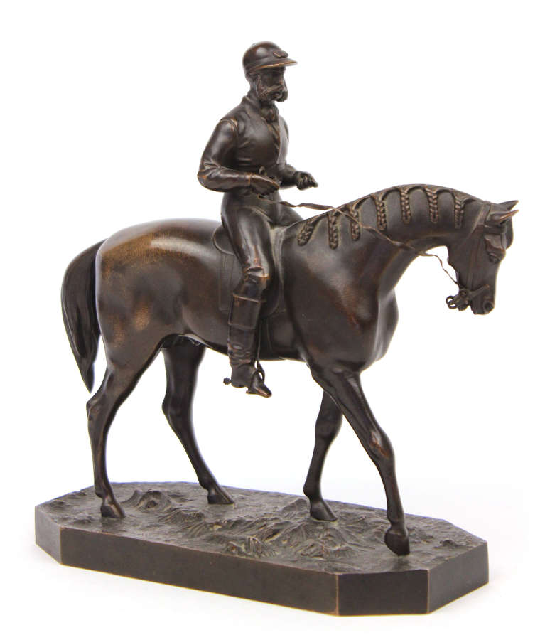 A 19th Century Bronze sculpture of a jockey and horse