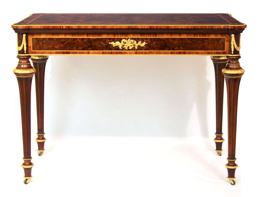 An Exceptional Walnut Inlaid and Ormolu Mounted Card Table
