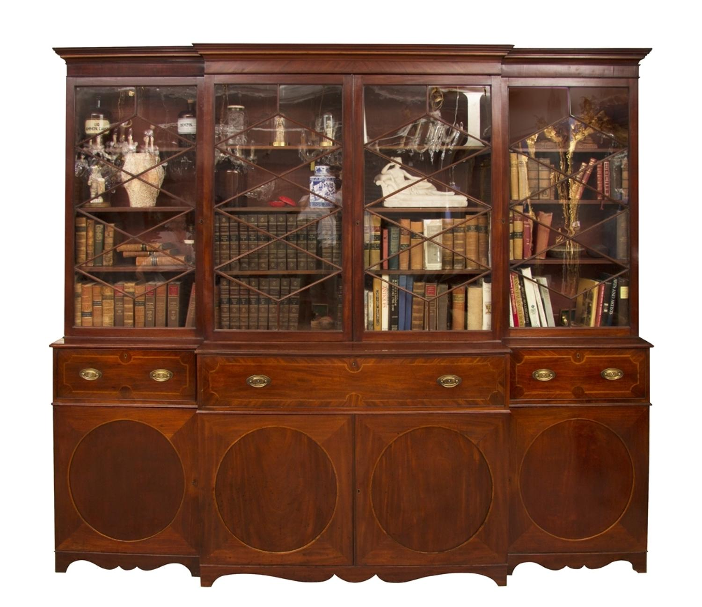 A Georgian mahogany breakfront secretaire bookcase