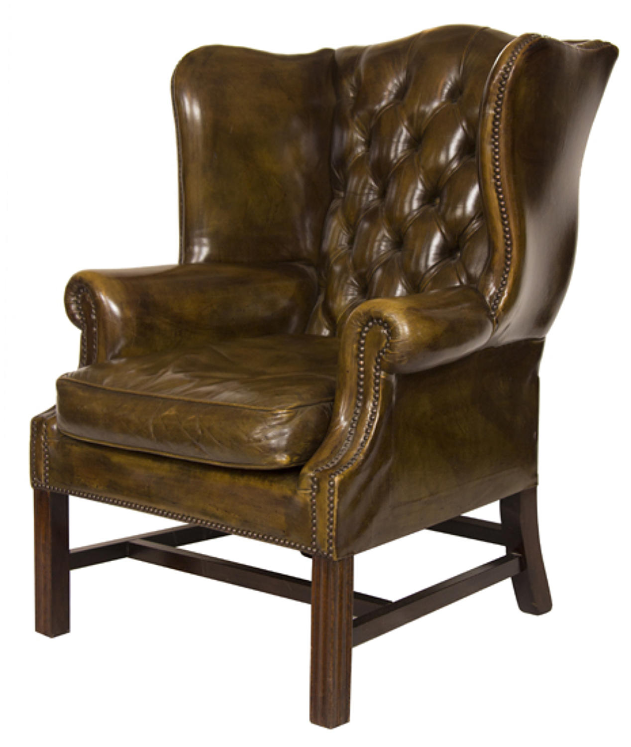 A superb deep green leather wing chair