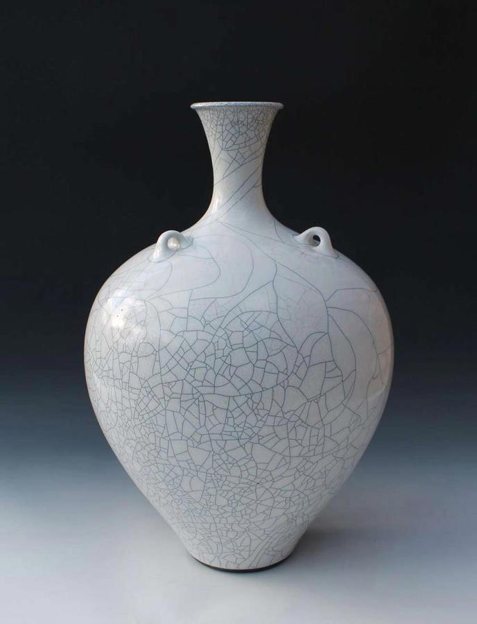 Peter Sparrey. Raku fired lugged bottle with tin glaze