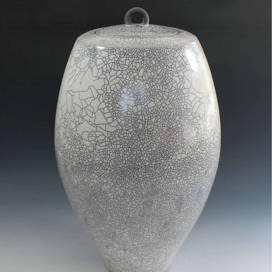 Peter sparrey. Raku lidded Jar with white crackle tin glaze.