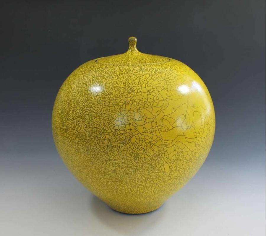 Peter Sparrey. Raku  lidded jar with imperial yellow crackle glaze