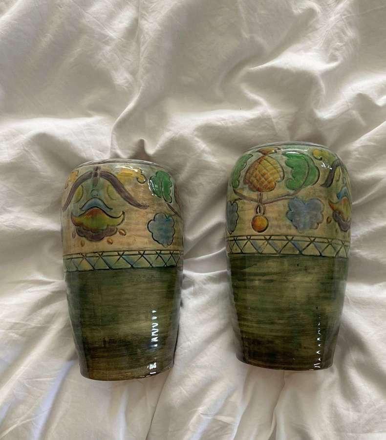 A Pair of Brangwynware Royal Doulton Vases.