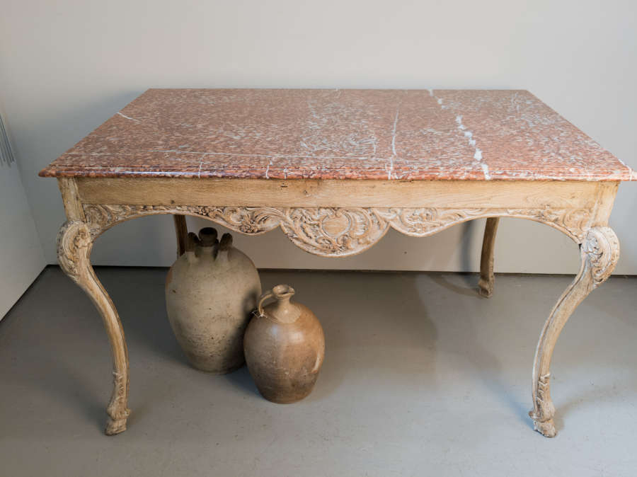 A 19th Century French oak table with marble top