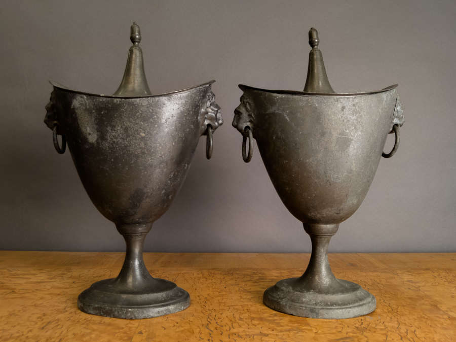 A Mid 19th Century pair of Pewter Chestnut Urns
